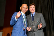 Honoree Mike Smith and Master of Ceremonies Bob Costas pose with the Sports Legend award during the 33rd Annual Great Sports Legends Dinner, which raised millions of dollars for the Buoniconti Fund to Cure Paralysis at The New York Hilton Midtown on September 24, 2018 in New York City.