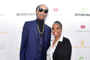 Snoop Dogg (L) and Shante Broadus attend the 34th Annual Cedars-Sinai Sports Spectacular at The Compound on July 15, 2019 in Inglewood, California.