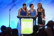 (L-R) Olympic softball player Jessica Mendoza, former Olympic soccer player Angela Hucles, and journalist Hannah Storm speak onstage at the 34th annual Salute to Women In Sports Awards at Cipriani, Wall Street on October 16, 2013 in New York City.