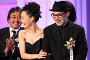 Director Tetsuya Nakashima (R) accepts the Best Picture award for 'Kokuhaku' (Confessions) on stage beside actress Yoshino Kimura during the 34th Japan Academy Awards at Grand Prince Hotel New Takanawa on February 18, 2011 in Tokyo, Japan.