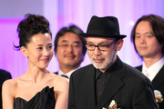 Director Tetsuya Nakashima holds a trophy on stage beside actress Yoshino Kimura (L) as he accepts the Best Picture award for 'Kokuhaku' (Confessions) during the 34th Japan Academy Awards at Grand Prince Hotel New Takanawa on February 18, 2011 in Tokyo, Japan.