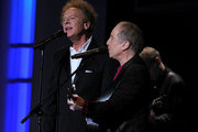 Musicians Art Garfunkel and Paul Simon of Simon & Garfunkel perform during the 38th AFI Life Achievement Award honoring Mike Nichols held at Sony Pictures Studios on June 10, 2010 in Culver City, California. The AFI Life Achievement Award tribute to Mike Nichols will premiere on TV Land on Saturday, June 25 at 9PM ET/PST.