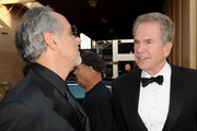 Actor Warren Beatty (R) and AFI Vice-Chairman Producer Jon Avnet arrive at the 38th AFI Life Achievement Award honoring Mike Nichols held at Sony Pictures Studios on June 10, 2010 in Culver City, California. The AFI Life Achievement Award tribute to Mike Nichols will premiere on TV Land on Saturday, June 25 at 9PM ET/PST.