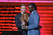 Chicago Bears cornerback Charles Tillman (R) wins the Walter Payton NFL Man of the Year at the 3rd Annual NFL Honors at Radio City Music Hall on February 1, 2014 in New York City.