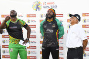 In this handout image provided by CPL T20,  Andre Russell (L) of Jamaica Tallawahs toss the coin as Chris Gayle (C) of St Kitts & Nevis Patriots and match referee Devdas Govindjee (R) look on at the start of the Hero Caribbean Premier League Play-Off match 32 between St Kitts & Nevis Patriots and Jamaica Tallawahs at Guyana National Stadium on September 12, 2018 in Providence, Guyana