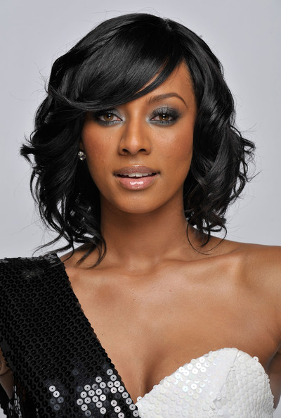 Check out the pictures below for more inspiration on cute black hairstyles
