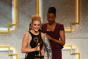 Actress Hunter King (L) accepts Outstanding Younger Actress in a Drama Series for 'The Young and the Restless' from actress Aisha Tyler onstage during The 41st Annual Daytime Emmy Awards at The Beverly Hilton Hotel on June 22, 2014 in Beverly Hills, California.