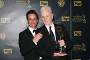 """Actors Christian LeBlanc (L) and Anthony Geary, winner of the award for Outstanding Lead Actor in a Drama Series for """"General Hospital"""" pose in the press room during The 42nd Annual Daytime Emmy Awards at Warner Bros. Studios on April 26, 2015 in Burbank, California."""