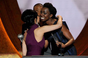 """Actress Archie Panjabi (L) accepts the award for Outstanding Supporting Actress in a Drama Series for """"The Good Wife"""" from actress Adepero Oduye onstage at the 43rd NAACP Image Awards held at The Shrine Auditorium on February 17, 2012 in Los Angeles, California."""