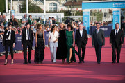 (L-R) Sara Giraudeau, Alex Baupin, Leila Slimani, Leila Bekhti, Sandrine Kiberlain, Sabine Azema, Stephane Brize, Xavier Legrand and Pierre Salvadori pose on the red carpet before the opening ceremony of the 44th Deauville US Film Festival on August 31, 2018 in Deauville, France.