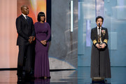 Vice Admiral Michelle Howard (R) accepts the Chairman's Award from actor Dennis Haysbert (L) and NAACP Chairman of the National Board of Directors Roslyn M. Brock (C) onstage during the 44th NAACP Image Awards at The Shrine Auditorium on February 1, 2013 in Los Angeles, California.