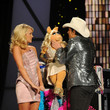She takes the stage with Miss Piggy and Brad Paisley.