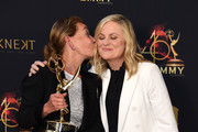 Judge Judy (L) poses with the Lifetime Achievement Award in the press room with Amy Poehler during the 46th annual Daytime Emmy Awards at Pasadena Civic Center on May 05, 2019 in Pasadena, California.