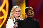 Judge Judy (R) accepts the Lifetime Achievement Award from Amy Poehler onstage at the 46th annual Daytime Emmy Awards at Pasadena Civic Center on May 05, 2019 in Pasadena, California.