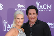 (L-R) Kathleen McCrone and singer Wayne Newton arrive at the 47th Annual Academy Of Country Music Awards held at the MGM Grand Garden Arena on April 1, 2012 in Las Vegas, Nevada.