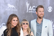 Singer Stevie Nicks (C) poses with musicians (L-R) Hillary Scott and Charles Kelley of Lady Antebellum at the 49th Annual Academy Of Country Music Awards at the MGM Grand Garden Arena on April 6, 2014 in Las Vegas, Nevada.