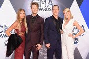 (L-R) Brittney Marie Cole, musicians Brian Kelley, Tyler Hubbard of Florida Georgia Line and Hayley Stommel attends the 49th annual CMA Awards at the Bridgestone Arena on November 4, 2015 in Nashville, Tennessee.