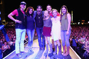 Singer Lee Brice (C) with guests Boston Gilbert, Ginger Gilbert Ravella, Bella Gilbert Ravella, Annalise Gilbert Ravella, Aspen Gilbert Ravella, and Greyson Ravella onstage at the 4th ACM Party for a Cause Festival at the Las Vegas Festival Grounds on April 2, 2016 in Las Vegas, Nevada.