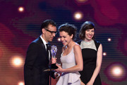 Actress Tatiana Maslany (C) accepts the Best Actress in a Drama Series award for 'Orphan Black' from actors Fred Armisen (L) and Carrie Brownstein (R) onstage during the 4th Annual Critics' Choice Television Awards at The Beverly Hilton Hotel on June 19, 2014 in Beverly Hills, California.