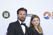 Lorenzo Lamas and Victoria Lamas attend the 4th annual Roger Neal Oscar Viewing Dinner Icon Awards and after party at Hollywood Palladium on February 24, 2019 in Los Angeles, California.