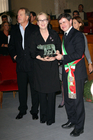 Actress Meryl Streep with the Mayor of Rome Gianni Alemanno (R) and her husband Don Gummer (L) as she receives the Marc'Aurelio award at a ceremony during Day 9 of the 4th International Rome Film Festival held at the Capital Hill on October 23, 2009 in Rome, Italy.