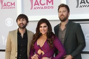 (L-R) Recording artists Dave Haywood, Hillary Scott, and Charles Kelley of music group Lady Antebellum arrive for the 52nd Academy of Country Music Awards on April 2, 2017, at the T-Mobile Arena in Las Vegas, Nevada. / AFP PHOTO / Tommaso Boddi