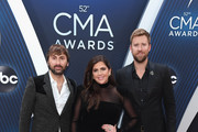 (FOR EDITORIAL USE ONLY) Dave Haywood,  Hillary Scott and Charles Kelley of Lady Antebellum attend the 52nd annual CMA Awards at the Bridgestone Arena on November 14, 2018 in Nashville, Tennessee.