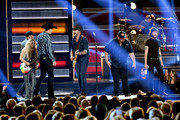 (FOR EDITORIAL USE ONLY) (L-R) Lindsay Ell, Jon Pardi, Luke Bryan, Luke Combs and Chris Janson perform onstage during the 52nd annual CMA Awards at the Bridgestone Arena on November 14, 2018 in Nashville, Tennessee.