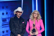 (FOR EDITORIAL USE ONLY) Brad Paisley and Carrie Underwood speak onstage during the 52nd annual CMA Awards at the Bridgestone Arena on November 14, 2018 in Nashville, Tennessee.