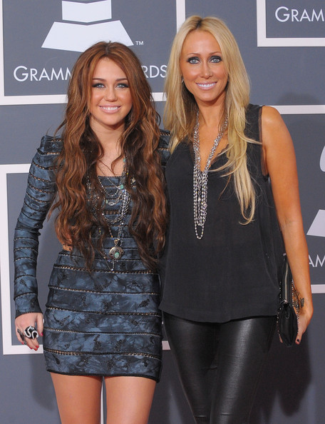 Tish Cyrus Singer Miley Cyrus (L) and mother Tish Cyrus arrive at the 52nd Annual GRAMMY Awards held at Staples Center on January 31, 2010 in Los Angeles, California.