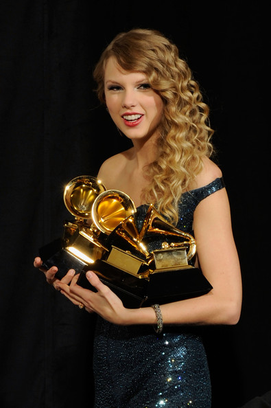 Singer Taylor Swift poses with Album Of The Year award for 'Fearless', Best Female Country Vocal Performance for 'White Horse', Best Country Song for 'Fearless' and Best Country Album for 'Fearless' in the press room during the 52nd Annual GRAMMY Awards held at Staples Center on January 31, 2010 in Los Angeles, California.