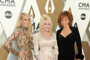 (FOR EDITORIAL USE ONLY) (L-R) Carrie Underwood, Dolly Parton and Reba McEntire attend the 53rd annual CMA Awards at the Music City Center on November 13, 2019 in Nashville, Tennessee.