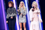 (FOR EDITORIAL USE ONLY) (L-R) Reba McEntire, Carrie Underwood and Dolly Parton speak onstage during the 53rd annual CMA Awards at the Music City Center on November 13, 2019 in Nashville, Tennessee.