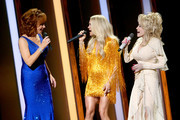 (FOR EDITORIAL USE ONLY) (L-R) Reba McEntire, Carrie Underwood, Dolly Parton perform onstage during the 53rd annual CMA Awards at the Music City Center on November 13, 2019 in Nashville, Tennessee.