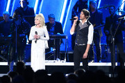 (FOR EDITORIAL USE ONLY)  Luke Smallbone of For King & Country and Dolly Parton (L) perform onstage during the 53rd annual CMA Awards at the Music City Center on November 13, 2019 in Nashville, Tennessee.
