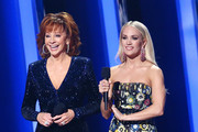 (FOR EDITORIAL USE ONLY) Reba McEntire (L) and Carrie Underwood speak onstage during the 53rd annual CMA Awards at the Bridgestone Arena on November 13, 2019 in Nashville, Tennessee.