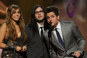 Singer Miley Cyrus, musician Nathan Followill and musician Jared Followill of Kings of Leon speak onstage during The 53rd Annual GRAMMY Awards held at Staples Center on February 13, 2011 in Los Angeles, California.