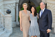 (L-R) Princess Charlene of Monaco, Robin Tunney and Prince Albert II of Monaco attend a cocktail party at the Monaco Palace on June 12, 2013 in Monte-Carlo, Monaco.