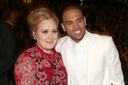 Singers Adele (L) and Chris Brown attend the 55th Annual GRAMMY Awards at Staples Center on February 10, 2013 in Los Angeles, California.