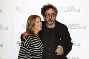 Filmmaker Tim Burton and actress Catherine O'Hara pose at the 'Frankenweenie 3D' photocall at the Corinthia Hotel London which, later tonight, opens the 56th BFI London Film Festival at Odeon Leicester Square on October 10, 2012 in London, England.