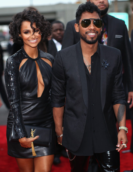 Songwriter Miguel Jontel Pimentel (R) and model Nazanin Mandi attend the 56th GRAMMY Awards at Staples Center on January 26, 2014 in Los Angeles, California.