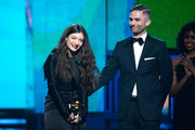 Singer/songwriter Lorde (L) and songwriter Joel Little accept the Song of the Year award for 'Royals' onstage during the 56th GRAMMY Awards at Staples Center on January 26, 2014 in Los Angeles, California.