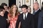 Actress Karen Martinez (L) and recording artist Juanes attend The 57th Annual GRAMMY Awards at the STAPLES Center on February 8, 2015 in Los Angeles, California.