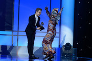 Recording artists Hunter Hayes (L) and Angelique Kidjo appear onstage during the The 57th Annual GRAMMY Awards Premiere Ceremony at Nokia Theatre L.A. Live on February 8, 2015 in Los Angeles, California.