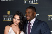 Lilit Avagyan (L) and NFL player Reggie Bush attend the 5th Annual NFL Honors at Bill Graham Civic Auditorium on February 6, 2016 in San Francisco, California.