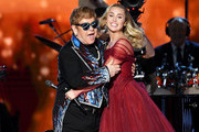 Recording artists Sir Elton John (L) and Miley Cyrus perform onstage during the 60th Annual GRAMMY Awards at Madison Square Garden on January 28, 2018 in New York City.