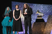 """Meghan Foley, Annie Stoll, and """"Weird Al"""" Yankovic accept award for Boxed or Special Limited Edition Package onstage at the 61st Annual GRAMMY Awards Premiere Ceremony at Microsoft Theater on February 10, 2019 in Los Angeles, California."""