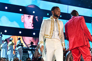Images for the late Nipsey Hussle and Kobe Bryant are projected onto a screen while John Legend and YG perform onstage during the 62nd Annual GRAMMY Awards at STAPLES Center on January 26, 2020 in Los Angeles, California.