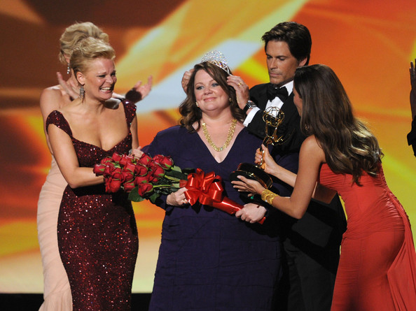 Actress Melissa McCarthy (C) accepts the Outstanding Lead Actress in a Comedy Series award onstage with Martha Plimpton (L), Rob Lowe, and Sophia Vergara during the 63rd Annual Primetime Emmy Awards held at Nokia Theatre L.A. LIVE on September 18, 2011 in Los Angeles, California.