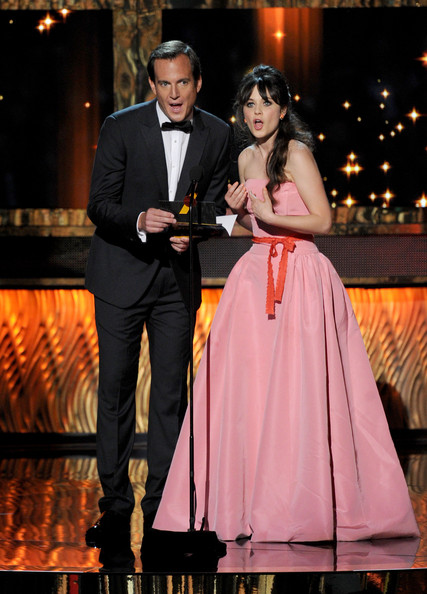 Actors Will Arnett (L) and Zooey Deschanel speak onstage during the 63rd Annual Primetime Emmy Awards held at Nokia Theatre L.A. LIVE on September 18, 2011 in Los Angeles, California.